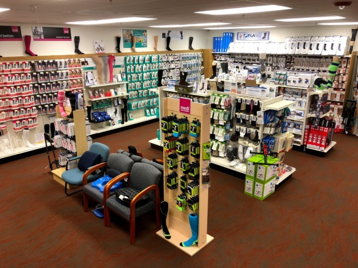 A photo of the compression hosiery and braces & supports on the Oswald's Pharmacy Medical Equipment Showroom floor. Hundreds of products are on the shelves.