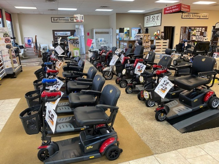 A photo of the mobility scooters and power chairs on the medical equipment showroom floor at All-Star Medical. Dozens of scooters and chairs are on display.