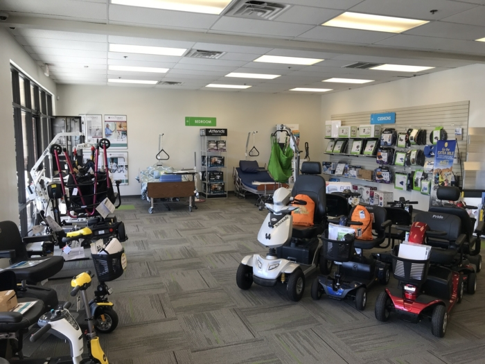 The Medical Equipment Showroom floor at Valley Medical Supplies. Mobility scooters, hospital beds, patient lifts, and aids to daily living are displayed on the floor.